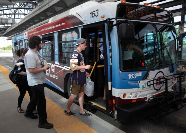 Bomber fans board a bus at Osborne Station for the ride to Investors Group Field for Monday night's CFL exhibition game between the Winnipeg Blue Bombers and the Toronto Argonauts.