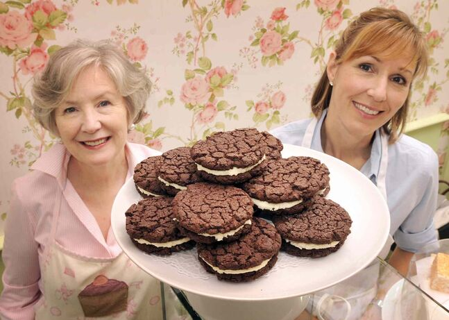 Pixie Porcellato (left) and Rosie Daykin  with The Homemade You-Know-What cookies.