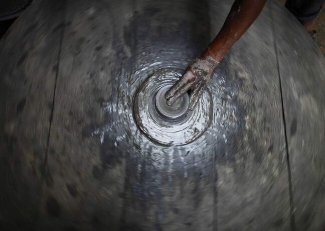 A Nepalese potter makes a pot on a wheel in Bhaktapur, Nepal. (AP Photo/Niranjan Shrestha)