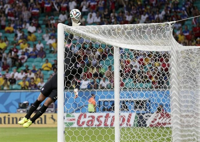United States' goalkeeper Tim Howard leaps to make a save during the World Cup round of 16 soccer match between Belgium and the USA at the Arena Fonte Nova in Salvador, Brazil, Tuesday, July 1, 2014. (AP Photo/Marcio Jose Sanchez)