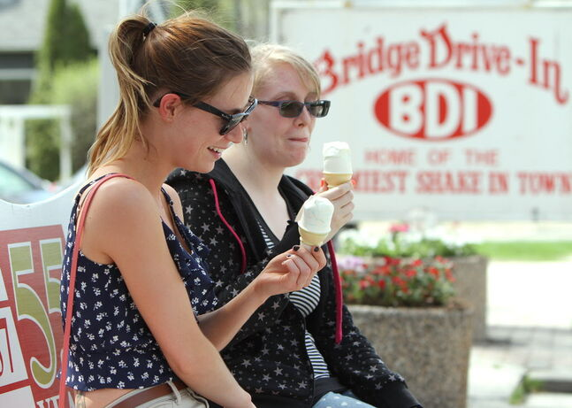 Britney Bell (left) and Kaeley Gould enjoy ice cream at Bridge Drive-In on Saturday.