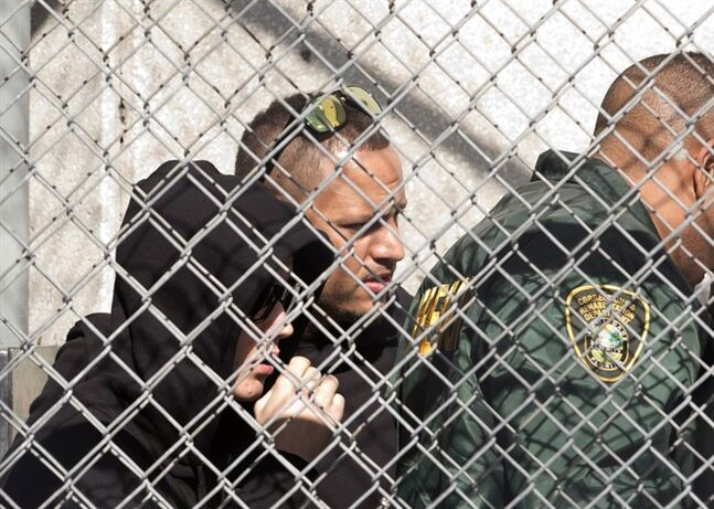 Justin Bieber, left, is escorted out of the Turner Guilford Knight Correctional Center, Thursday Jan. 23, 2014 in Doral, Fla., THE CANADIAN PRESS/AP, Wilfredo Lee