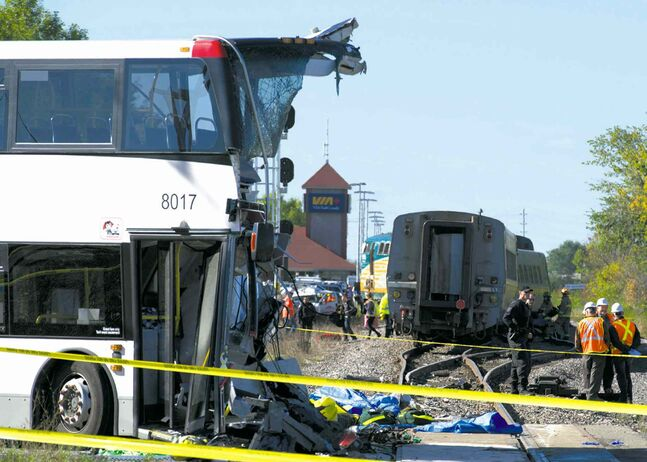 The front of the OC Transpo bus was ripped off and the Via locomotive and a passenger car were derailed in the collision.   . The crash ripped off the front of the bus during the morning commute, Wednesday September 18, 2013 in Ottawa. THE CANADIAN PRESS/Adrian Wyld