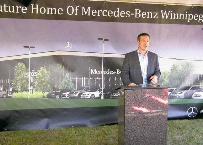 Mercedes-Benz Winnipeg president Brian Lowes with illustration of the new dealership being built on Kenaston Boulevard.