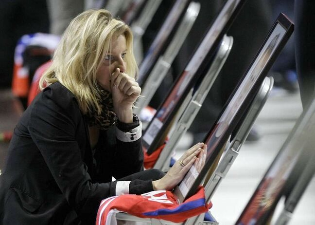 A relative of one of the victims of the plane crash grieves at a memorial service in the Arena Yaroslavl on Saturday, Sept. 10, 2011.