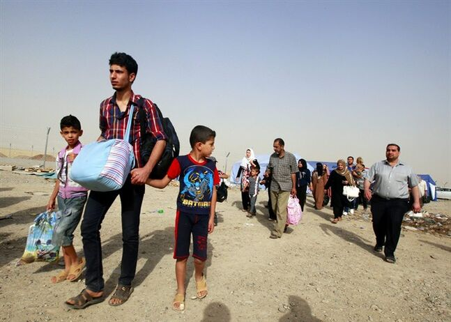 Refugees fleeing from Mosul head to the self-ruled northern Kurdish region in Irbil, Iraq, 350 kilometers (217 miles) north of Baghdad, Thursday, June 12, 2014. The Islamic State of Iraq and the Levant, the al-Qaida breakaway group, on Monday and Tuesday took over much of Mosul in Iraq and then swept into the city of Tikrit further south. An estimated half a million residents fled Mosul, the economically important city. (AP Photo)