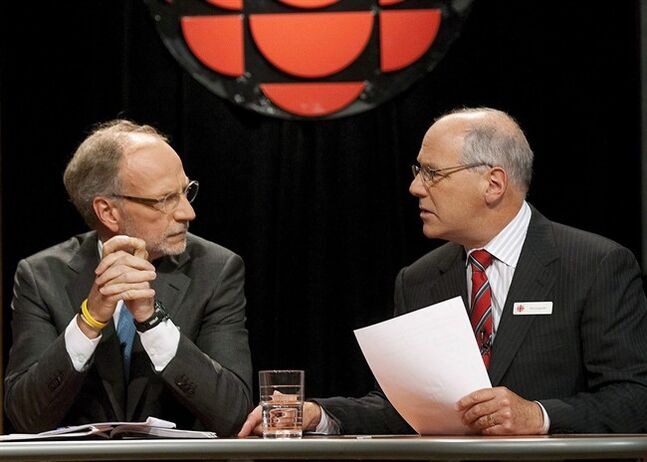 CBC Chairman Tim Casgrain speaks with CEO Hubert Lacroix in Ottawa on Sept. 23, 2009. THE CANADIAN PRESS/Pawel Dwulit