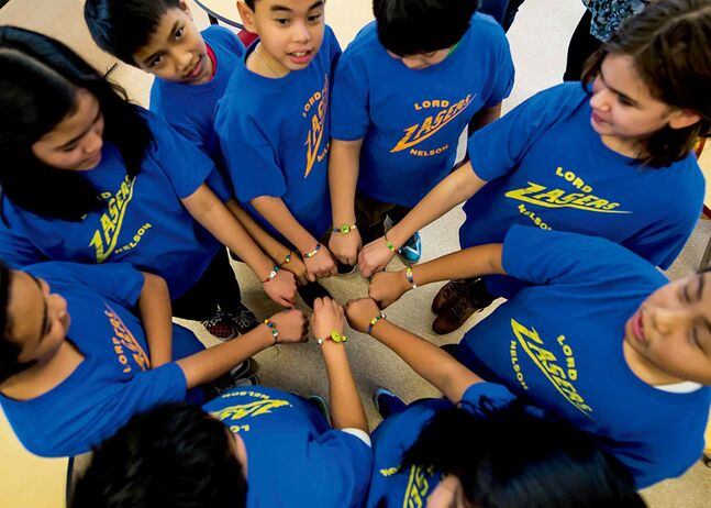 "Lord Nelson School's Goal 2020 kids show off the ""basic needs bracelets"" they made in support of Winnipeg Harvest."
