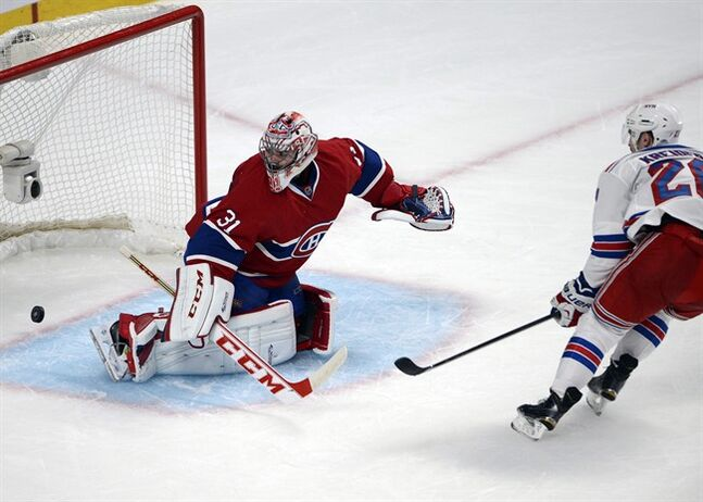Carey Price watches Chris Kreider's goal on Saturday, May 17, 2014. THE CANADIAN PRESS/Ryan Remiorz