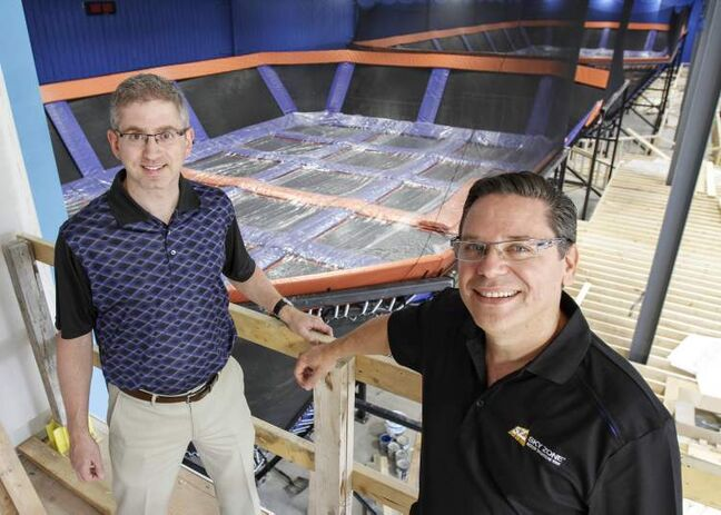 The Sky Zone Indoor Trampoline Park will open its doors at the corner of McGillivray Boulevard and McCreary Road Aug. 17. Owner Arnold Cohn (right), a Winnipeg chiropractor, and real estate broker Jack Hurtig check out the site recently.