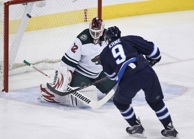 Winnipeg Jets winger Evander Kane scores on Minnesota Wild goaltender Niklas Backstrom during the first period.