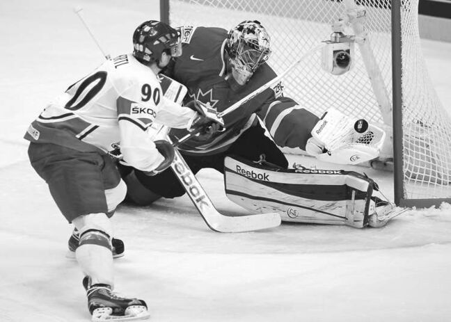 Canada's goalie Mike Smith robs Tomas Hertl of the Czech Republic during first-period action in Stockholm on Sunday.