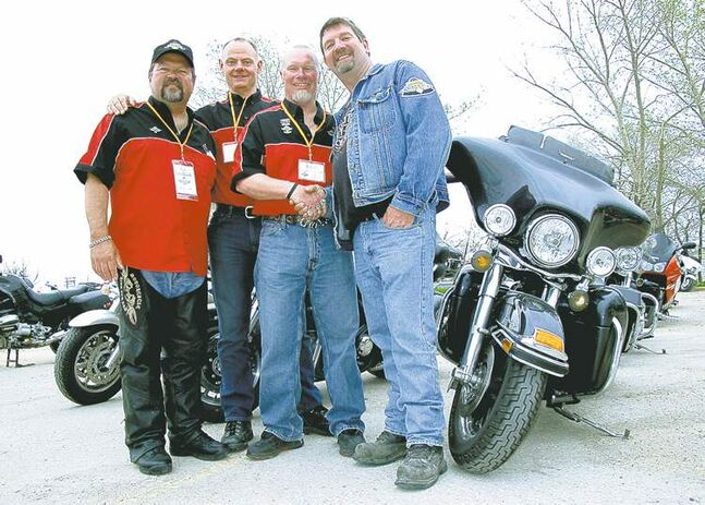 From left, Winnipeg Police Service officers and Ride for Dad co-chairs Kirk Van Alstyne and Moe Sabourin, with spokesperson Ed Johner and top pledge earner Tony Kusiak, who single-handedly raised more than $13,000.