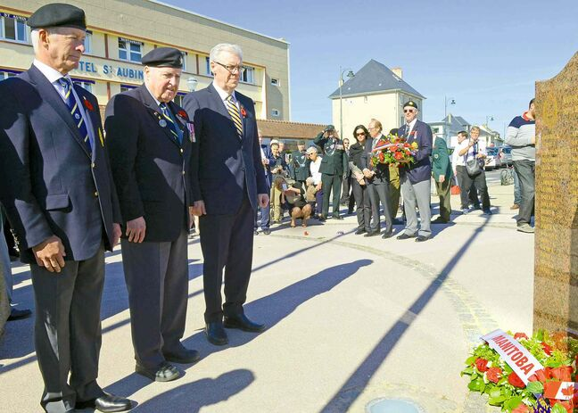 Greg Selinger at the memorial for the Fort Garry Horse in Saint-Aubin-sur-Mer. With Selinger are Brian Hastings, the regiment�s honorary colonel (left), and D-Day vet Stan Butterworth.