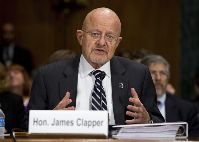 National Intelligence Director James Clapper testifies on Capitol Hill in Washington, Wednesday, Oct. 2, 2013, before the Senate Judiciary Committee oversight hearing on the Foreign Intelligence Surveillance Act. U.S. intelligence officials say the government shutdown is seriously damaging the intelligence community's ability to guard against threats. (AP Photo/ Evan Vucci)