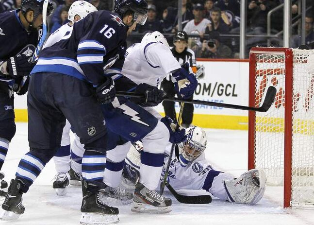 Tampa Bay Lightning goaltender Cedrick Desjardins stops a shot from Winnipeg Jets' Andrew Ladd (16) during the second period of an NHL game in Winnipeg on Sunday.