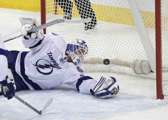 Tampa Bay Lightning's goaltender Anders Lindback (39) can't stop the shot from Winnipeg Jets' Olli Jokinen (12) during first period of the game at MTS Centre Tuesday.