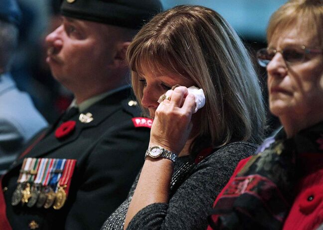 A woman weeps during a Remembrance Day service at the RBC Convention Centre Winnipeg on Tuesday, Nov. 11, 2013.
