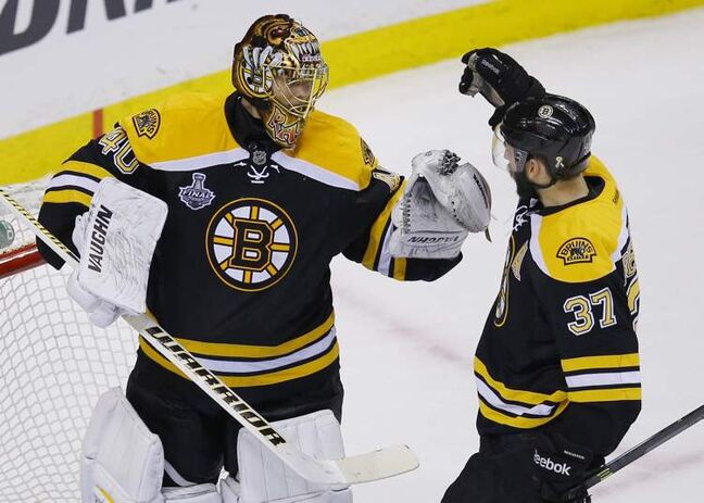 Two of the stars of the game -- goalie Tuukka Rask with the shutout and centre Patrice Bergeron with a goal -- celebrate their win Monday.