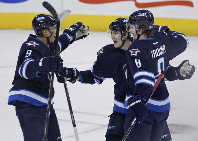 Evander Kane (left), Mark Scheifele (centre) and Jacob Trouba celebrate Trouba's goal against the Florida Panthers during the first period of Friday's 5-2 win.