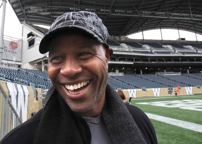Winnipeg Blue Bomber great James (Wild) West smiles during a visit to Investors Group Field Thursday. The two-time CFL all-star and some of his Bomber teammates from the 1988 Grey Cup-winning team will be honoured at half-time of the Bombers' final game of the season, Saturday at IGF. West will be joined by 1988 Bomber teammates for an autograph-signing session today from 5:30 p.m.-7 p.m. at the Bomber Store at the new stadium.