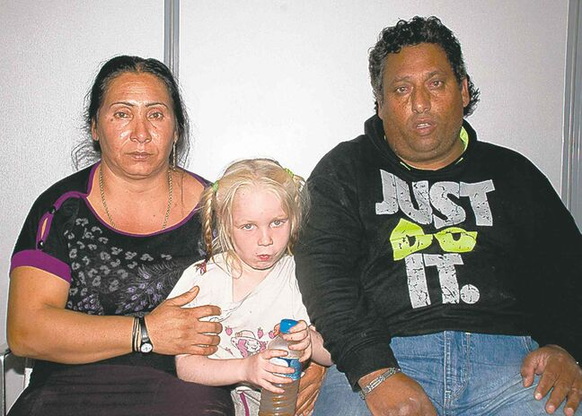 A girl found in a Roma camp in Greece and her alleged abductors.