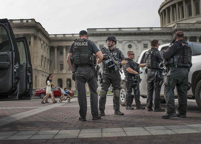 Heavily armed Capitol police guard the east front of the U.S. Capitol plaza area.