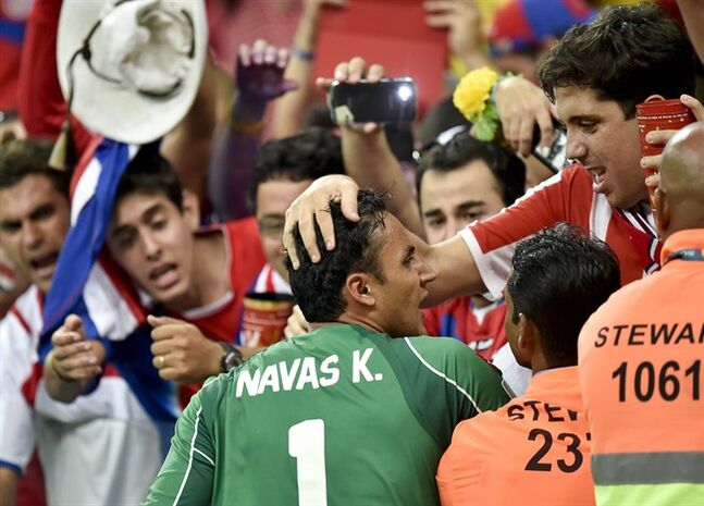 Costa Rica's goalkeeper Keylor Navas is congratulated by supporters after Costa Rica defeated Greece 5-3 in penalty shootouts after a 1-1 tie during the World Cup round of 16 soccer match between Costa Rica and Greece at the Arena Pernambuco in Recife, Brazil, Sunday, June 29, 2014. (AP Photo/Martin Meissner)