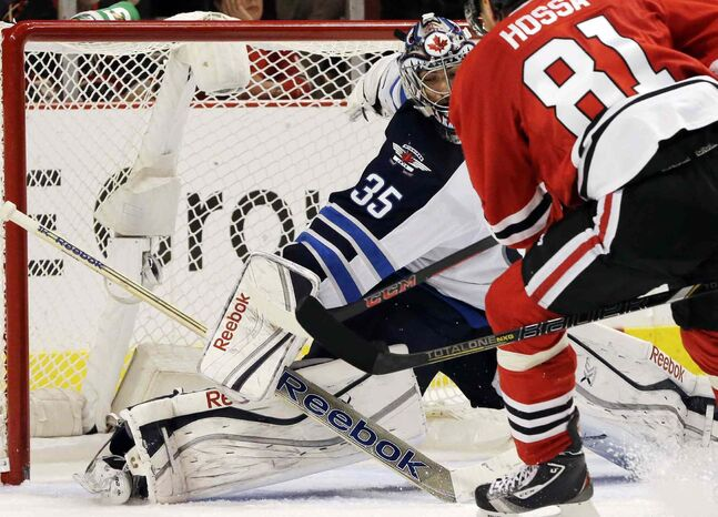 Winnipeg Jets goalie Al Montoya (35) blocks a shot by Chicago Blackhawks' Marian Hossa (81) during the second period.