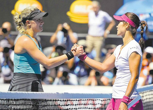 Li Na of China (right) shakes hands with Eugenie Bouchard of Canada after Li won their semifinal in Melbourne today.