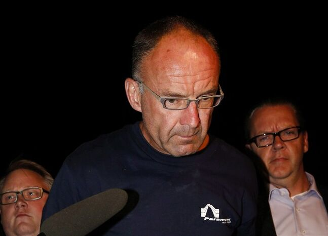 Douglas Garland is escorted into a Calgary police station in connection with the disappearance of Nathan O'Brien and his grandparents in Calgary, Alta., on July 14, 2014. The Crown has stayed identity theft charges against a man accused of murder in the deaths of a five-year-old Calgary boy and his grandparents. Garland was initially charged with identity theft in a matter unrelated to the disappearance of Nathan O'Brien and Alvin and Kathy Liknes in June. THE CANADIAN PRESS/Jeff McIntosh