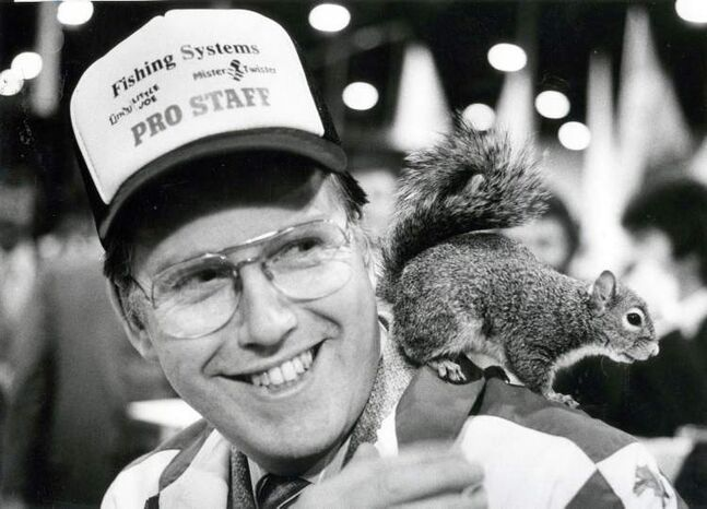 Mayor Bill Norrie gets acquainted with Twiggy the waterskiing squirrel during the Winnipeg International Boat Show, 1982.