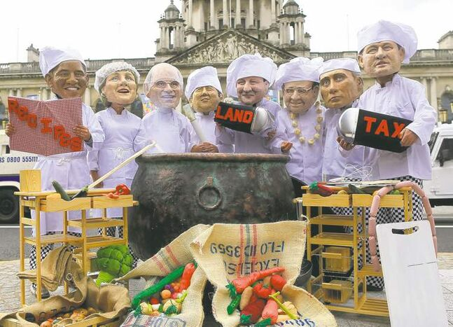 Members of Oxfam wear masks depicting G8 leaders outside Belfast City Hall, Northern Ireland in June.