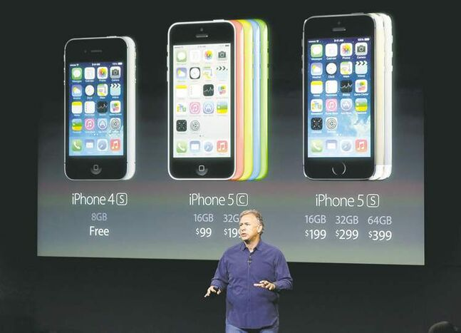 Phil Schiller, Apple's senior vice-president of worldwide product marketing, speaks during the debut of iPhone 5c and 5s on Tuesday.