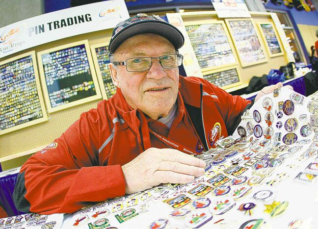 Keith Forbes shows off some of his collectible curling pins during Roar of the Rings Tuesday.