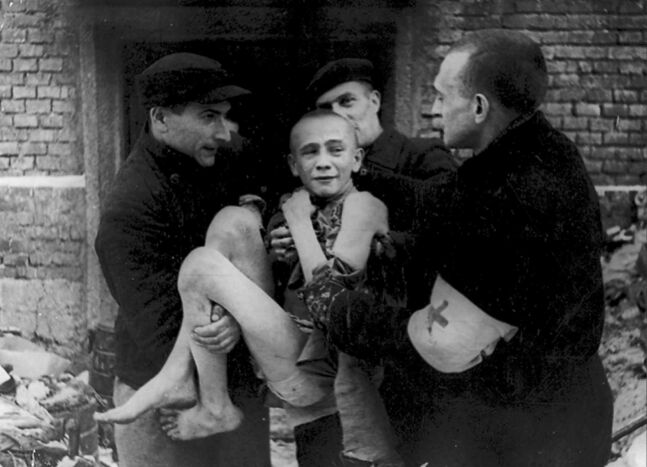 In one of the photographs on display as part of Photrocity, Ivan Dudnik, a 15-year-old Russian, is carried at Auschwitz in 1945.