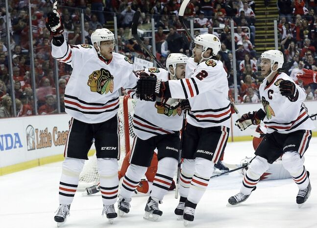 Chicago Blackhawks right wing Marian Hossa (left) celebrates the opening goal of the game — a power-play marker — with Andrew Shaw, Duncan Keith (2) and Jonathan Toews (19) during the first period.