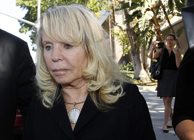 Shelly Sterling, the estranged wife of Los Angeles Clippers owner Donald Sterling, leaves a Los Angeles courthouse Monday, July 7, 2014. A jurisdictional issue delayed Monday's scheduled start of a trial focusing on whether Donald Sterling's estranged wife had the authority under terms of a family trust to unilaterally negotiate a $2 billion sale of the Los Angeles Clippers. (AP Photo/Nick Ut)