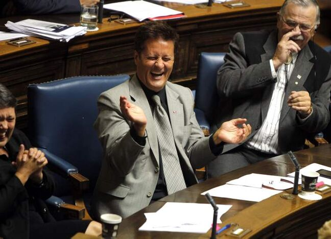 Ron Schuler (centre) gestures during the last question period in the longest session of the Manitoba legislature.