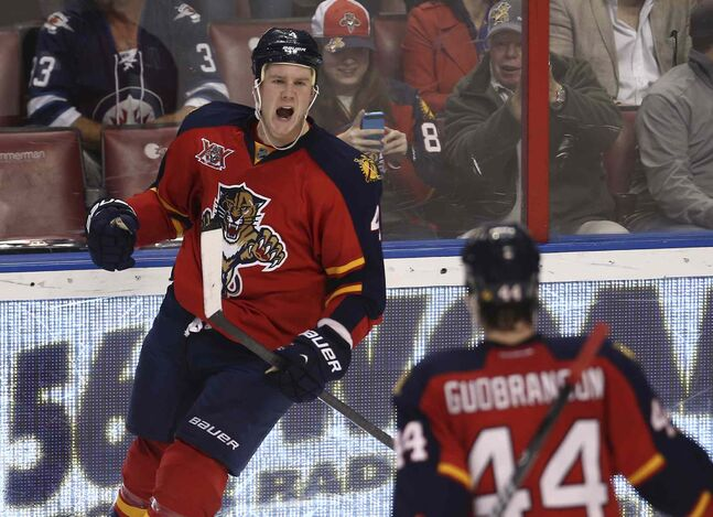 Florida Panthers' Dylan Olsen (left) celebrates with Erik Gudbranson after scoring a goal against the Winnipeg Jets during the second period.