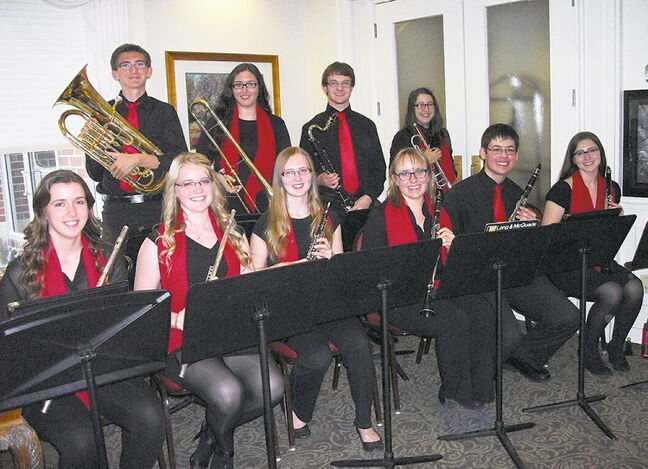 The 12-member Winds of Sturgeon wind ensemble, made up of students from College Sturgeon Heights Collegiate, played seven shows at retirement homes in June. SUPPLIED PHOTO