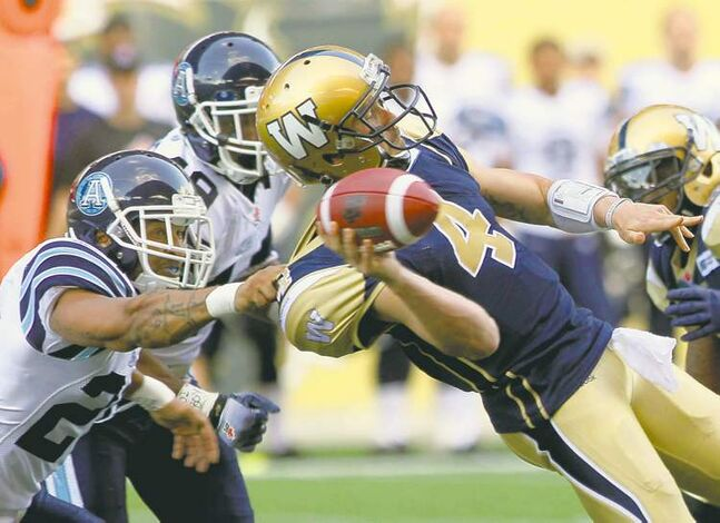 Winnipeg quarterback Buck Pierce is sacked by Toronto linebacker Bryan Payton during first-quarter action at Investors Group Field Wednesday night.