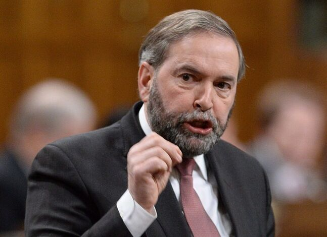 NDP Leader Tom Mulcair asks a question during question period in the House of Commons in Ottawa, Thursday, January 30, 2014. The NDP is renewing its mission to cap ATM fees. A motion calling for the cap will be debated in the House of Commons on Monday. It urges the Conservative government to take action on ATM fees in its upcoming federal budget. THE CANADIAN PRESS/Sean Kilpatrick
