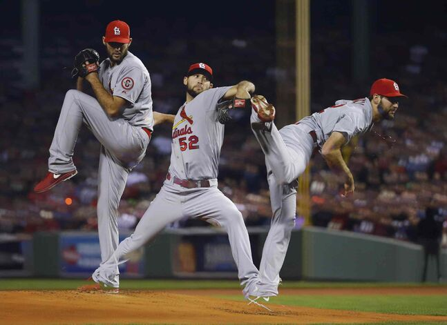In a multiple exposure, St. Louis Cardinals starting pitcher Michael Wacha throws during the first inning.