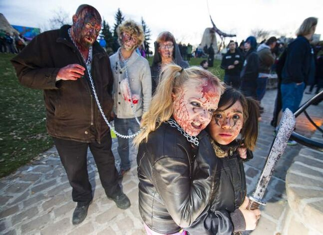 (L-R front) Marie Phillips, Jaida Ironstandt, (back L-R), Mike Phillips, Brett Phillips, and David Arndt during the annual Winnipeg Zombie Walk from The Forks to The Manitoba Legislative Building Saturday night. 