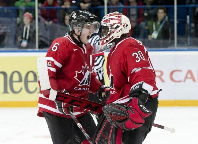 Goalie Malcolm Subban and defenceman Scott Harrington celebrate Canada's 2-1 win over the United States.