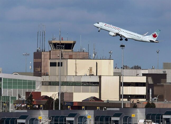 An Air Canada passenger jet takes off from Halifax on Jan. 21, 2013. THE CANADIAN PRESS/Andrew Vaughan