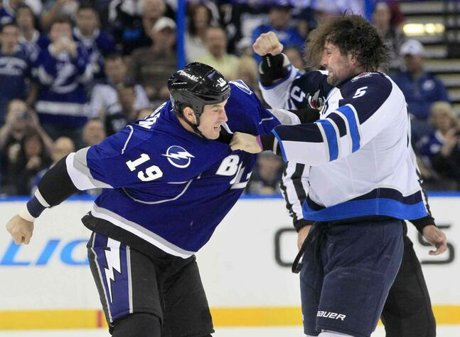The Tampa Bay Lightning's B.J. Crombeen (left) drops the gloves with the Winnipeg Jets defenceman Mark Stuart during the first period.