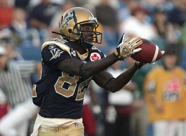 Winnipeg Blue Bombers  vs  Montreal Bombers at CanadInns Stadium - Bomber #82 Terrence Edwards  makes catch and run for TD. 