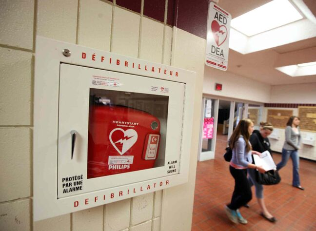 A portable defibrillator unit sits in a hallway at a high school in Brandon, Man.